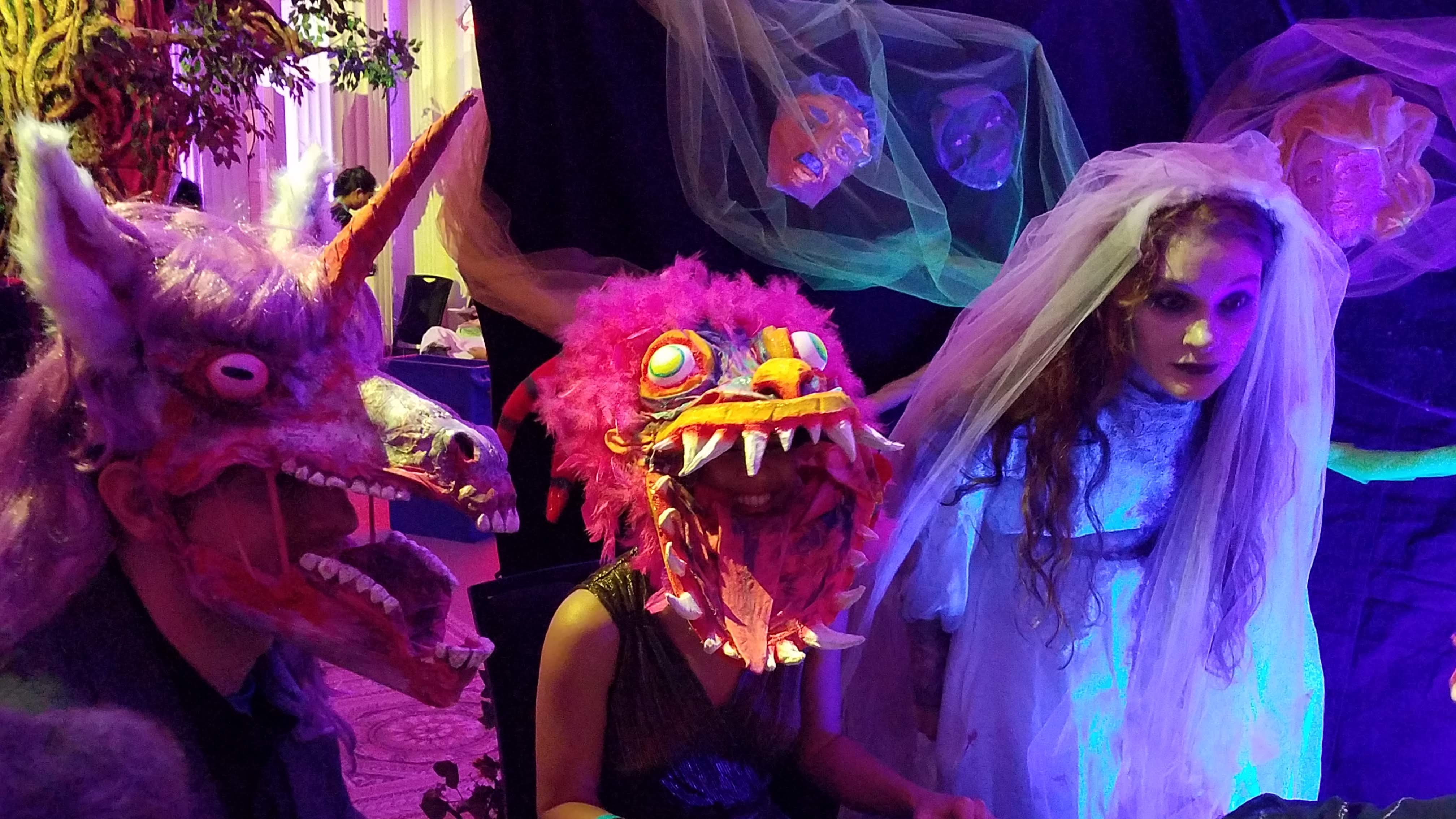 Halloween celebrants in masks at the 45th Northwest Filmmaker's Kickoff party: Portland Museum of Art.